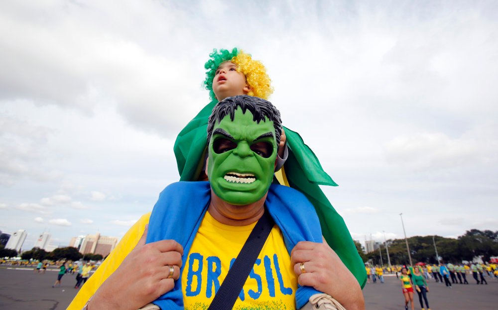 . A Brazil fan wearing a Hulk mask arrives for the group A World Cup soccer match between Cameroon and Brazil at the Estadio Nacional in Brasilia, Brazil, Monday, June 23, 2014. (AP Photo/Dolores Ochoa)