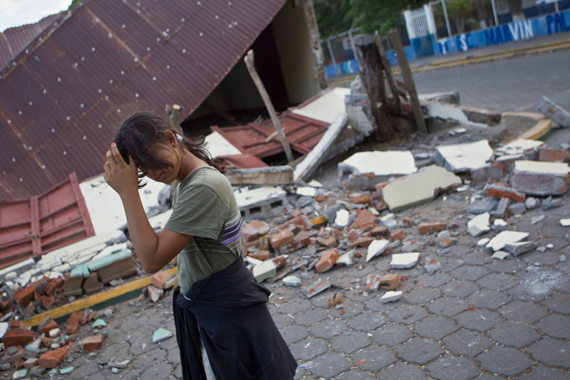 . A girl walks in front a home damaged by an earthquake in Nagarote, Nicaragua, Friday, April 11, 2014. Nicaragua\'s President Daniel Ortega declared red alert Friday after an earthquake of 6.2 magnitude on the Richter scale that shook the country on Thursday and left one dead, hundreds of houses damaged and thousands of people affected . (AP Photo/Esteban Felix)