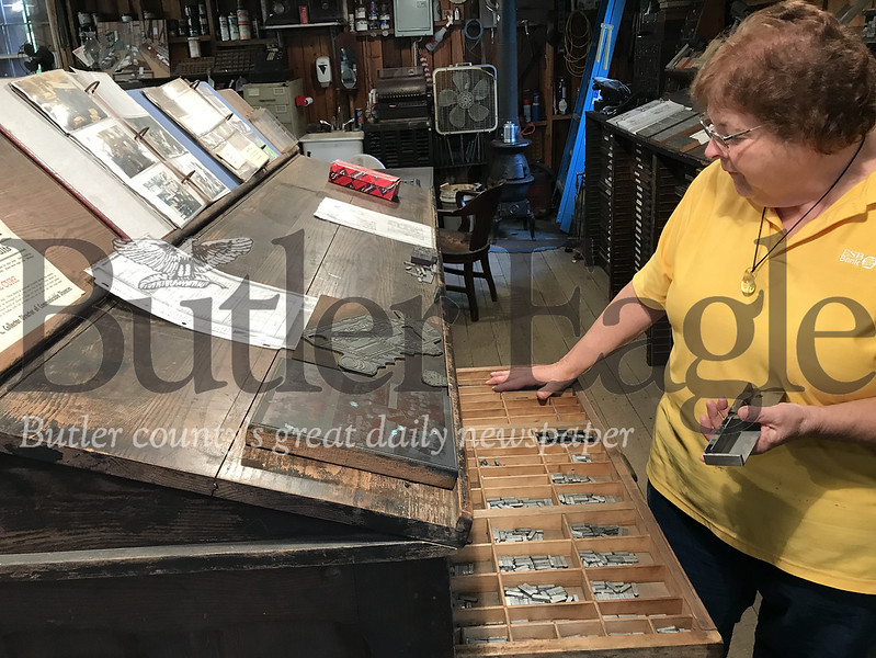 Nancy Young of Fombell gives a tour of a 1920s print shop at the Portersville Fall Fling Steam Show. Photo by Gabriella Canales