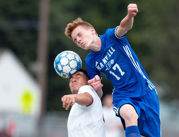 09/07/18 Wesley Bunnell | Staff Plainville boys soccer vs Bristol Central at Plainville High School on Friday evening. Bristol Central's Kenni Centarero (13) and Plainville's Nathan Cyr (17).