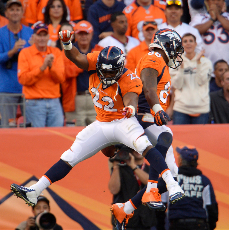 . Denver Broncos wide receiver Demaryius Thomas (88) and CJ Anderson celebrate a touchdown against the Washington Redskins.  (Photo by Joe Amon/The Denver Post)
