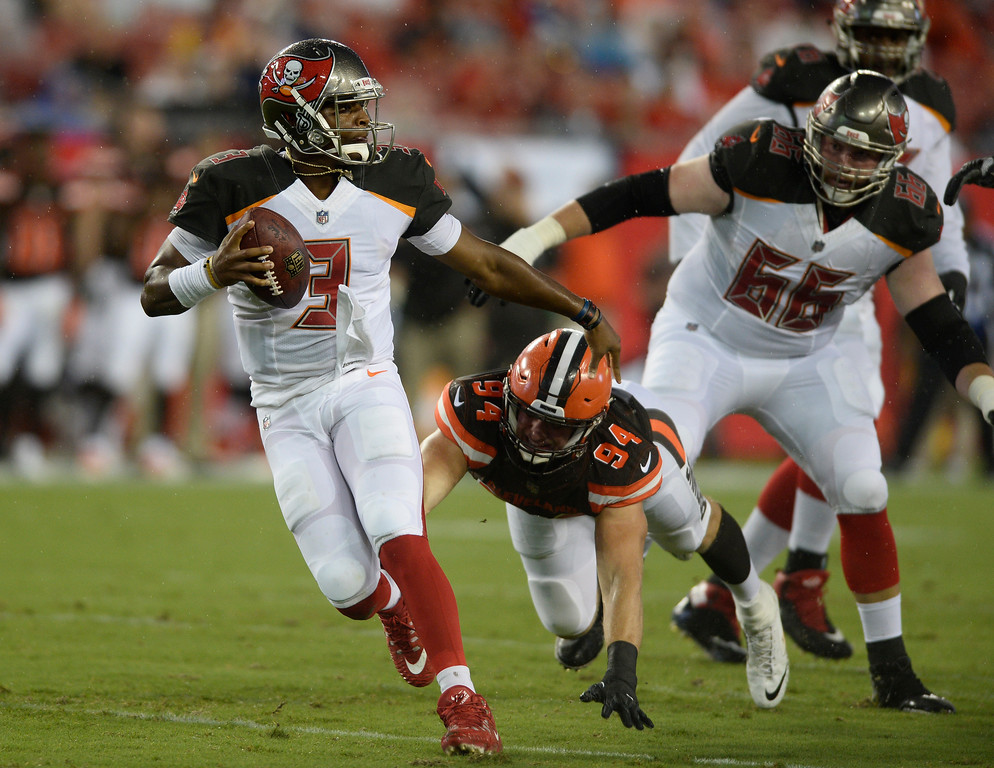 . Tampa Bay Buccaneers quarterback Jameis Winston (3) scrambles away from Cleveland Browns defensive end Carl Nassib (94) during the second quarter of an NFL preseason football game Saturday, Aug. 26, 2017, in Tampa, Fla. (AP Photo/Jason Behnken)
