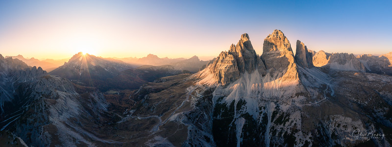 """Tre Cime di Lavaredo (Italian for """"Three Peaks of Lavaredo""""), also called the Drei Zinnen, are three distinctive battlement-like peaks, in the Sexten Dolomites of northeastern Italy.  They are probably one of the best-known mountain groups in the Alps.  They lie on the border between the Italian provinces of South Tyrol and Belluno and still are part of the linguistic boundary between German-speaking and Italian-speaking majorities.  The Cima Grande has an elevation of 2,999 meters (9,839 ft)."""