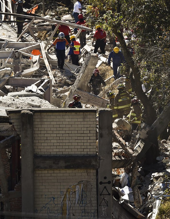 . Rescuers work amid the wreckage caused by an explosion in a hospital in Cuajimalpa, Mexico City, on January 29, 2015. A gas tank truck blew up outside a children\'s hospital in Mexico City on Thursday, killing at least four people and injuring dozens, including 22 children, as the building partly collapsed.    AFP PHOTO/RONALDO  SCHEMIDT/AFP/Getty Images