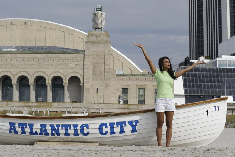 """. <p><b> The new Miss America, Nina Davuluri, has received a shocking amount of Twitter hate from trolls who are upset because she is � </b> <p> A. Indian  <p> B. Asian  <p> C. Way way WAY out of their league  <p><b><a href=\'http://www.orlandosentinel.com/features/blogs/gone-viral/os-miss-america-racism-20130916,0,4789897.post\' target=\""""_blank\"""">HUH?</a></b> <p>    (AP Photo/Julio Cortez)"""