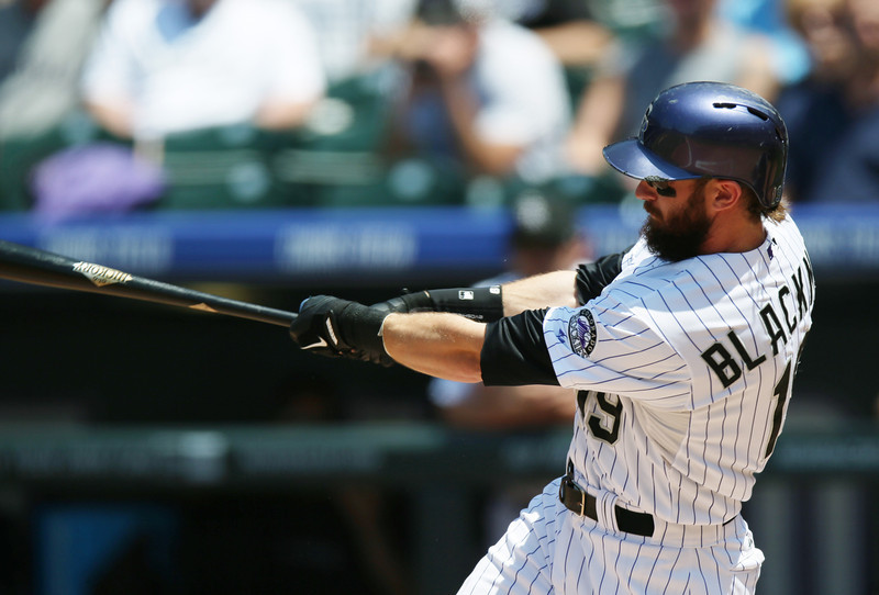 . Colorado Rockies\' Charlie Blackmon follows through with his swing after connecting for a two-run home run against the Atlanta Braves in the third inning of a baseball game in Denver on Thursday, June 12, 2014. (AP Photo/David Zalubowski)