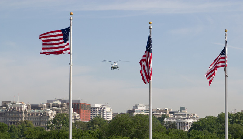 Marine One landing at the White House to drop off the president.