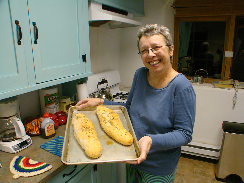 Crissie Buckwater bakes our communion bread in the kitchen at Casa del Sol.   http://stillpointca.org/ghostranch.html