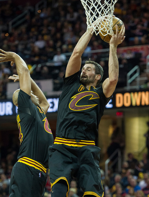 . Cleveland Cavaliers\' Kevin Love grabs a rebound in front of teammate Richard Jefferson during the second half of a basketball game against the New York Knicks in Cleveland, Tuesday, Oct. 25, 2016. the Cavaliers won 117-88.  (AP Photo/Phil Long)