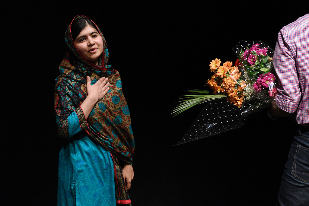 ". Pakistani rights activist Malala Yousafzai gestures after addressing the media in Birmingham, central England on October 10, 2014. The Nobel Peace Prize went Friday to 17-year-old Pakistani Malala Yousafzai and India\'s Kailash Satyarthi for their work promoting children\'s rights. Seventeen-year-old Nobel Peace Prize winner Malala Yousafzai said she was ""honored\"" to be the first Pakistani and the youngest person to be given the award and dedicated the award to the \""voiceless\"". \""This award is for all those children who are voiceless, whose voices need to be heard,\"" she said. AFP PHOTO / OLI  SCARFF/AFP/Getty Images"