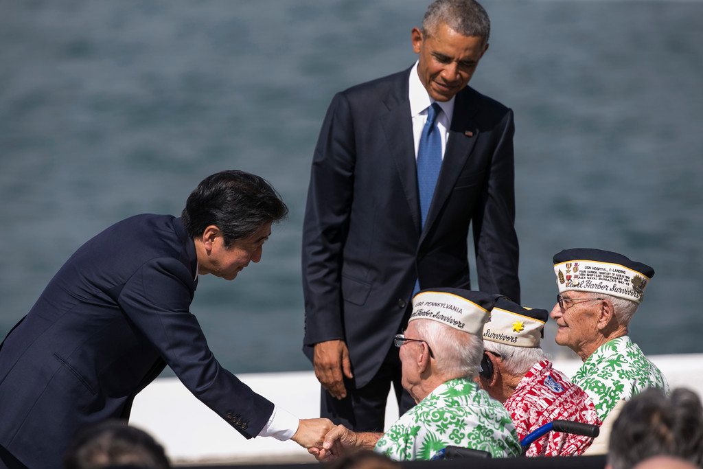 . Japanese Prime Minister Shinzo Abe, left, and U.S. President Barack Obama speaks with Pearl Harbor veterans, all seated from left, Sterling Cale, Al Rodrigues and Everett Hyland at Joint Base Pearl Harbor Hickam, Tuesday, Dec. 27, 2016, in Honolulu. Abe and Obama made a historic pilgrimage Tuesday to the site where the devastating surprise attack sent America marching into World War II. (AP Photo/Marco Garcia)