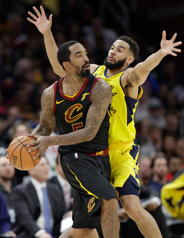 . Cleveland Cavaliers\' JR Smith, left, looks to pass against Indiana Pacers\' Cory Joseph in the second half of Game 1 of an NBA basketball first-round playoff series, Sunday, April 15, 2018, in Cleveland. The Pacers won 98-80. (AP Photo/Tony Dejak)