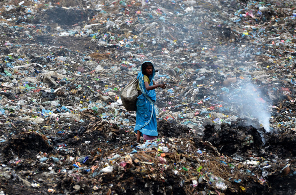 . An Indian ragpicker walks among heaps of rubbish at a municipal waste dump in Dimapur, on April 22, 2013. India\'s cities are becoming more polluted and unhealthy, according to a new survey published June 6, 2013, showing growing concern about the impact of high economic growth on the environment. The Energy and Resources Institute (TERI) research group based in New Delhi questioned 4,039 people living in India\'s six biggest cities about their perceptions, opinions and awareness of the environment and green issues over the last five years. STRDEL/AFP/Getty Images