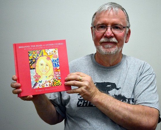 5/31/2018 Mike Orazzi | Staff Gregory Danilewicz holds a book of stories written by his daughter Sara.