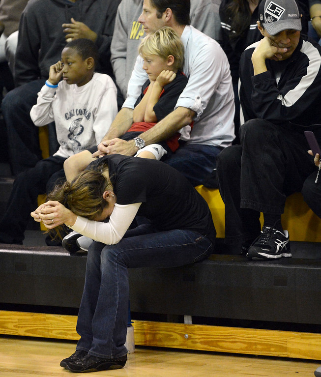 . Bishop Montgomery fans look dejected as seconds run out against La Verne Lutheran in a CIF SS Division IV-AA semifinal game in Torrance Friday night. Lutheran stunned Bishop Montgomery 63-59, ending their unbeaten season. 20130222 Photo by Steve McCrank / Staff Photographer