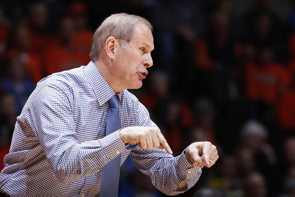. CHAMPAIGN, IL - MARCH 4:  Head coach John Beilein of the Michigan Wolverines gives instructions to his team during the first half of the game against the Illinois Fighting Illini at State Farm Center on March 4, 2014 in Champaign, Illinois. (Photo by Joe Robbins/Getty Images)