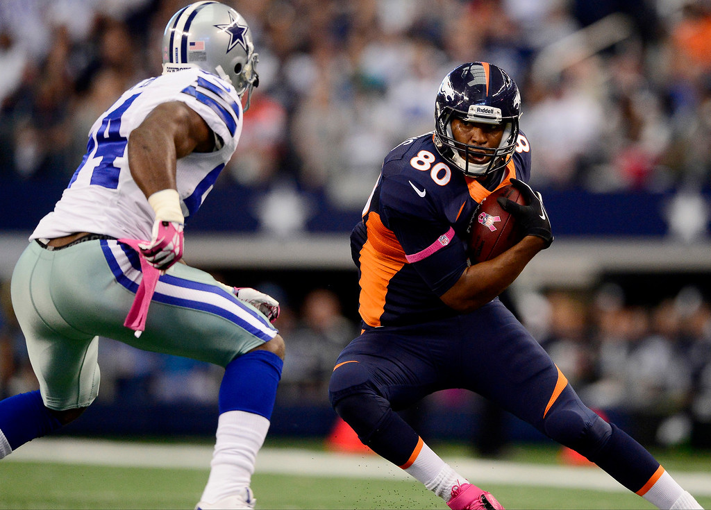 . Julius Thomas (80) of the Denver Broncos makes a move on Bruce Carter (54) of the Dallas Cowboys during the first half of action at AT&T Stadium.  (Photo by AAron Ontiveroz/The Denver Post)