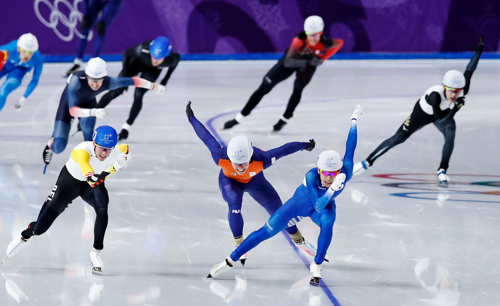 . Gold medalist Lee Seung-hoon of South Korea, leading, silver medalist Bart Swings of Belgium, left, and bronze medalist Koen Verweij of The Netherlands, center in orange, sprint towards the finish line during the men\'s mass start final speedskating race at the Gangneung Oval at the 2018 Winter Olympics in Gangneung, South Korea, Saturday, Feb. 24, 2018. (AP Photo/Vadim Ghirda)