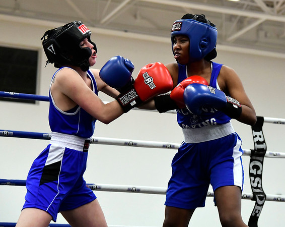 3/15/2019 Mike Orazzi | Staff Penn States Hannah Temple (red) and UConns Gail Mitchell (blue) in a 125 match during the National Collegiate Boxing Association National Qualifier held at the Bristol Boys & Girls Club in Bristol, Conn. Friday evening.