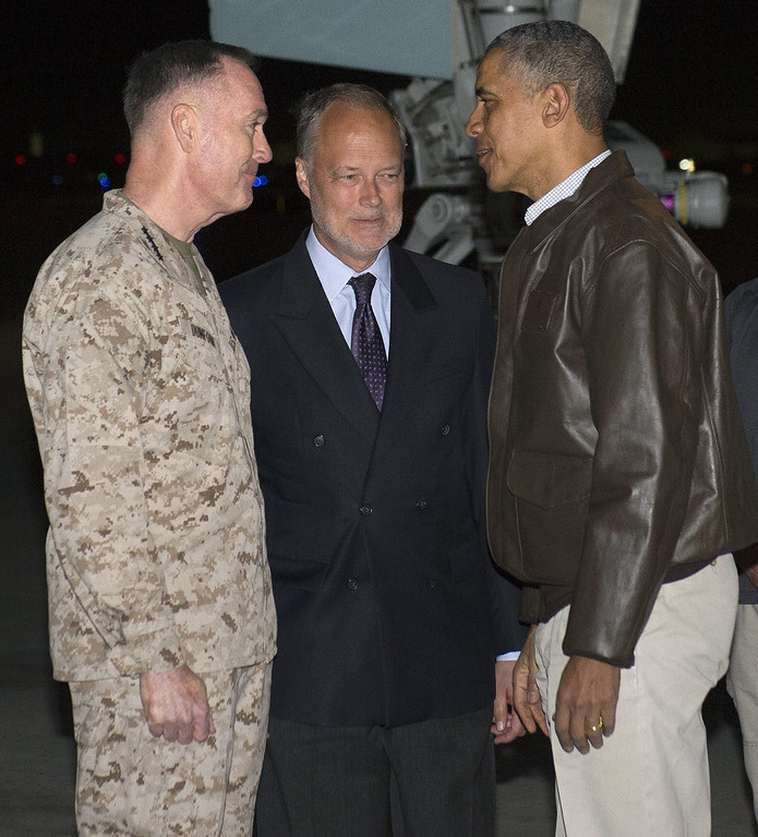 . US President Barack Obama greets US Ambassador to Afghanistan James Cunningham (C) and General Joseph Dunfore, Commander of ISAF and US Forces Afghanistan, after disembarking from Air Force One upon arrival at Bagram Air Field, north of Kabul, in Afghanistan, May 25, 2014, on a surprise trip to visit US troops prior to the Memorial Day holiday.   SAUL LOEB/AFP/Getty Images
