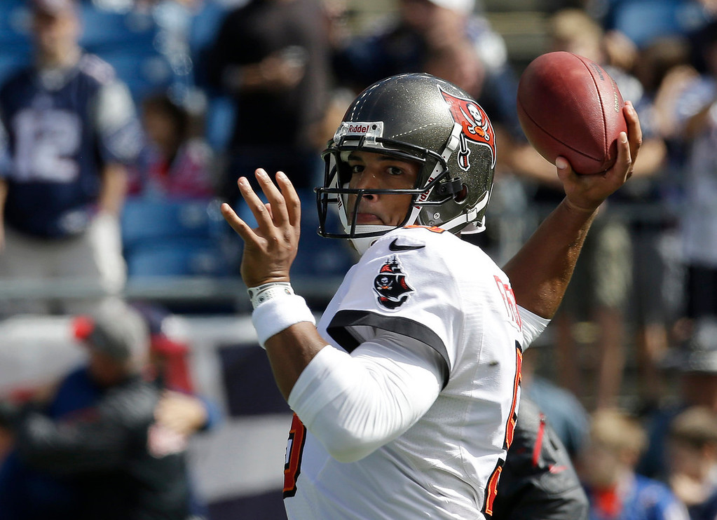 . Tampa Bay Buccaneers quarterback Josh Freeman warms up before an NFL football game against the New England Patriots Sunday, Sept. 22, 2013, in Foxborough, Mass. (AP Photo/Stephan Savoia)