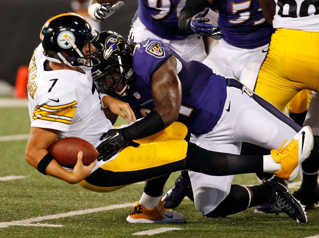 . Pittsburgh Steelers quarterback Ben Roethlisberger (7) is sacked by Baltimore Ravens outside linebacker Courtney Upshaw during the first half of an NFL football game Thursday, Sept. 11, 2014, in Baltimore. (AP Photo/Alex Brandon)
