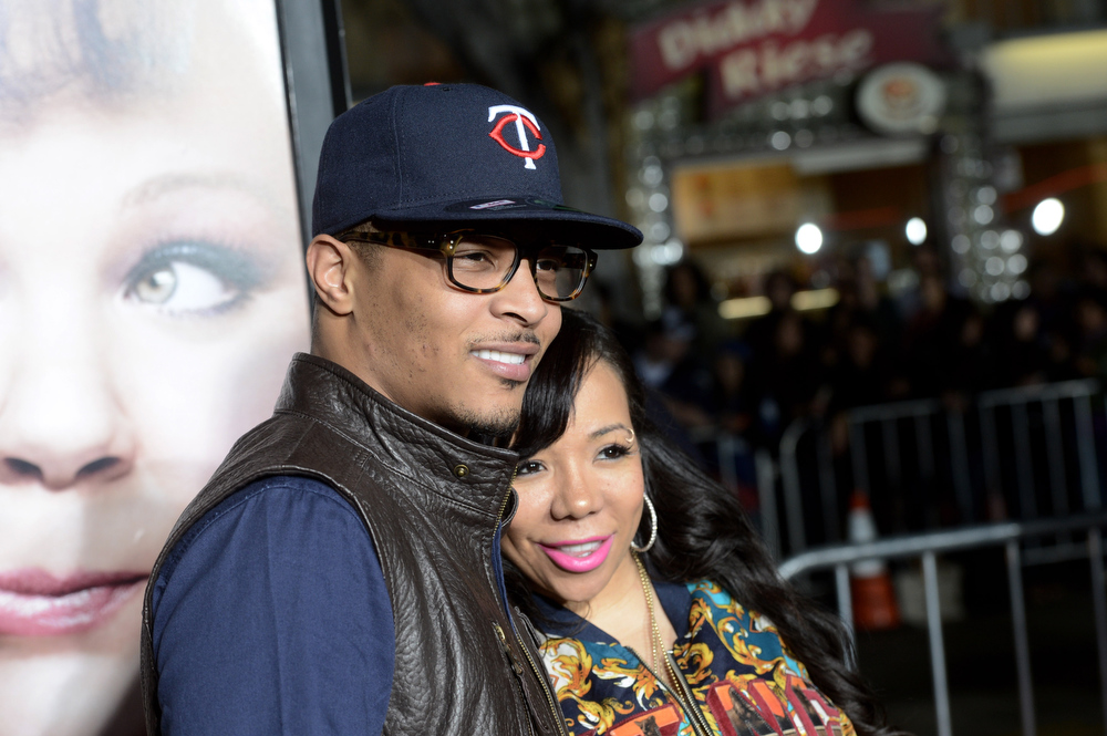 """. Actor/rapper T.I. (L) and his wife Tiny arrive at the premiere of Universal Pictures\' \""""Identity Theft\"""" at the Village Theatre on February 4, 2013 in Los Angeles, California.  (Photo by Kevin Winter/Getty Images)"""