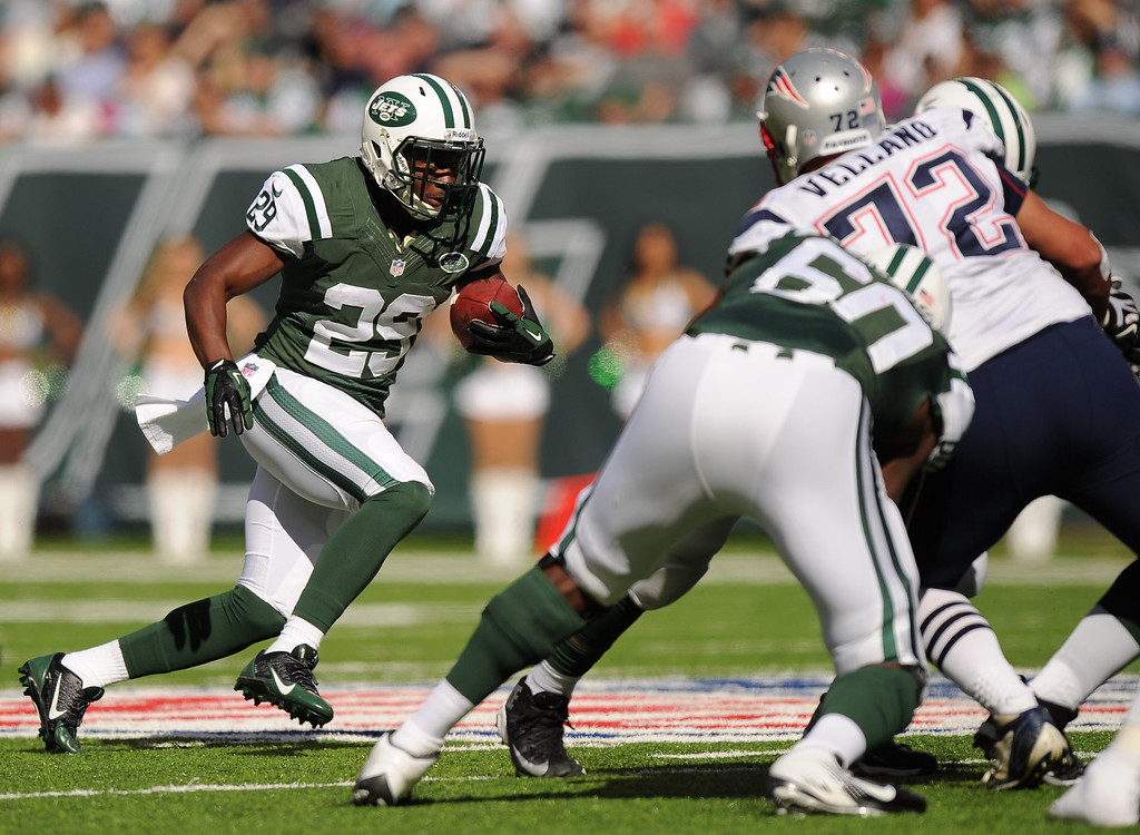. Bilal Powell #29 of the New York Jets carries the ball during the first half against the New England Patriots at MetLife Stadium on October 20, 2013 in East Rutherford, New Jersey.  (Photo by Maddie Meyer/Getty Images)