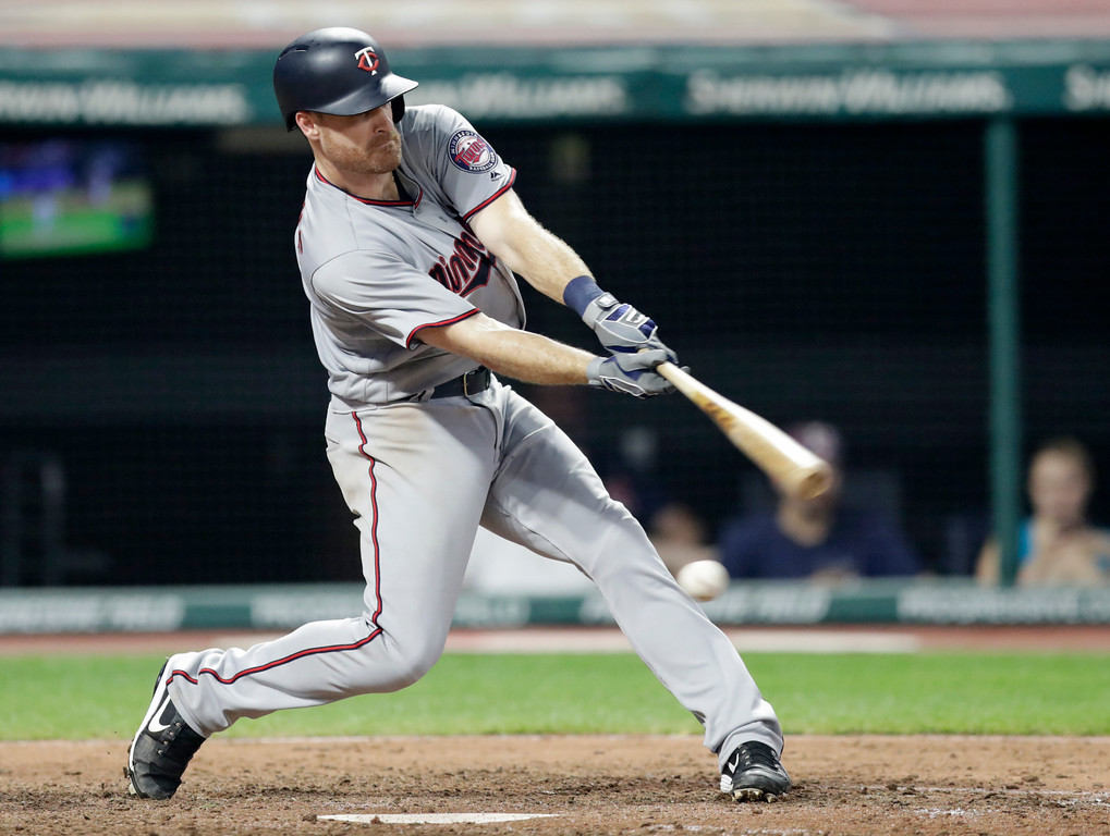 . Minnesota Twins\' Logan Forsythe swings for strike three in the eighth inning of a baseball game against the Cleveland Indians, Tuesday, Aug. 28, 2018, in Cleveland. (AP Photo/Tony Dejak)