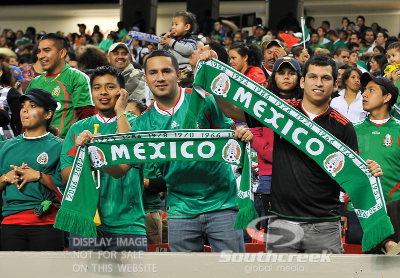 Fans of Mexico proudly show their allegiance during Soccer action between Bosnia-Herzegovina and Mexico.  Mexico defeated Bosnia-Herzegovina 2-0 in the game at the Georgia Dome in Atlanta, GA.