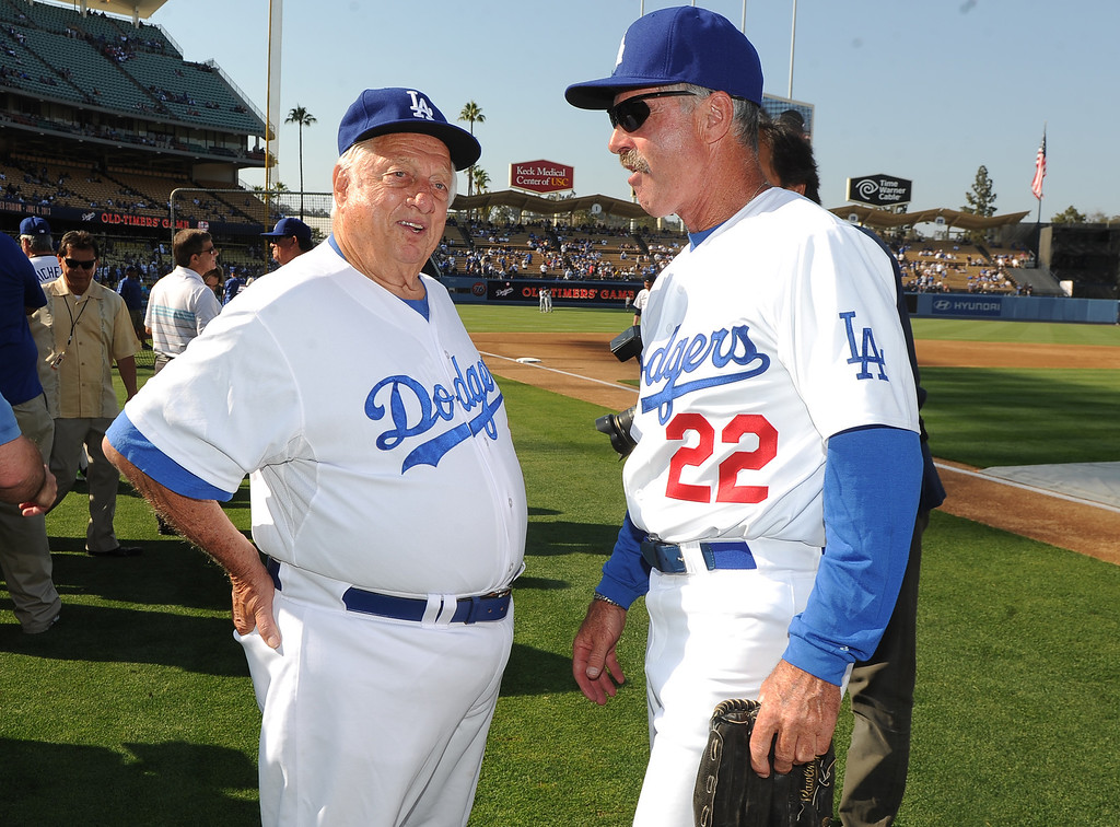 . Former Los Angeles Dodgers manager Tommy Lasorda, left, with Bill Buckner (22) during the Old-Timers game prior to a baseball game between the Atlanta Braves and the Los Angeles Dodgers on Saturday, June 8, 2013 in Los Angeles. 