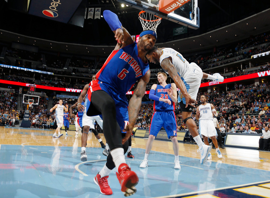 . Detroit Pistons forward Josh Smith, front, tries to stop after fouling Denver Nuggets forward Alonzo Gee as he goes up for a shot late in the fourth quarter of the Nuggets\' 89-79 victory in an NBA basketball game in Denver on Wednesday, Oct. 29, 2014. (AP Photo/David Zalubowski)