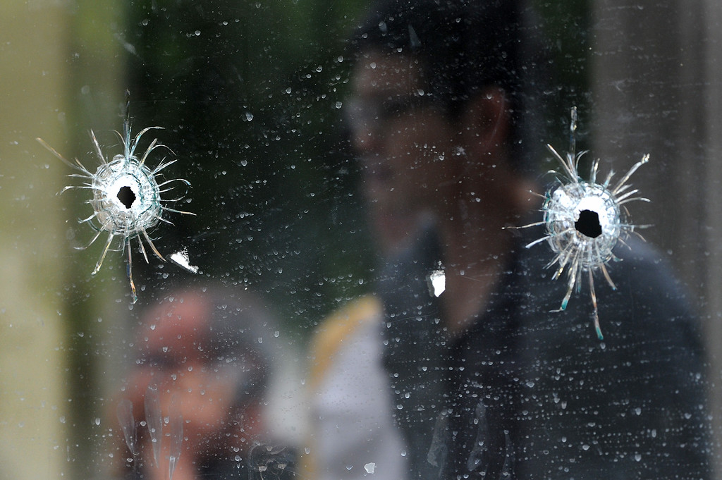 . Bullet holes in the store window of IV Deli Mart on Pardall Road in Isla Vista, Saturday, May 24, 2014, which was one of the scenes of Friday night\'s shootings. (Photo by Michael Owen Baker/Los Angeles Daily News)