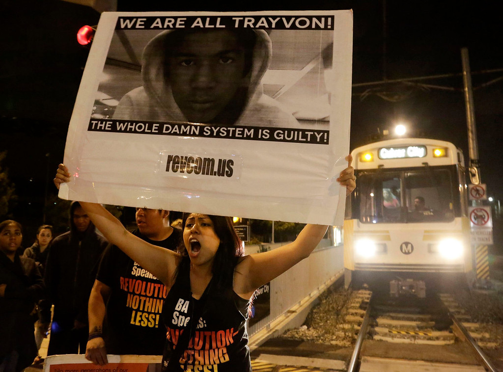 . A protester blocks an Expo Line train at the intersection of Exposition and Crenshaw boulevards, following the George Zimmerman verdict in Los Angeles, California, July 13, 2013. A Florida jury acquitted Zimmerman on Saturday for the shooting death of unarmed black teenager Trayvon Martin, setting free a man who had become a polarizing figure in the national debate over racial profiling and self-defense laws. REUTERS/Jason Redmond