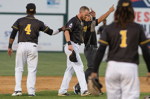 09/03/19 Wesley Bunnell | StaffrrThe New Britain Bees defeated the Somerset Patriots 7-6 in the bottom of the 8th on what was scheduled to be a 7 inning first game of a doubleheader. Ryan Jackson (8) is ejected by the third base umpire Eric Carmona .