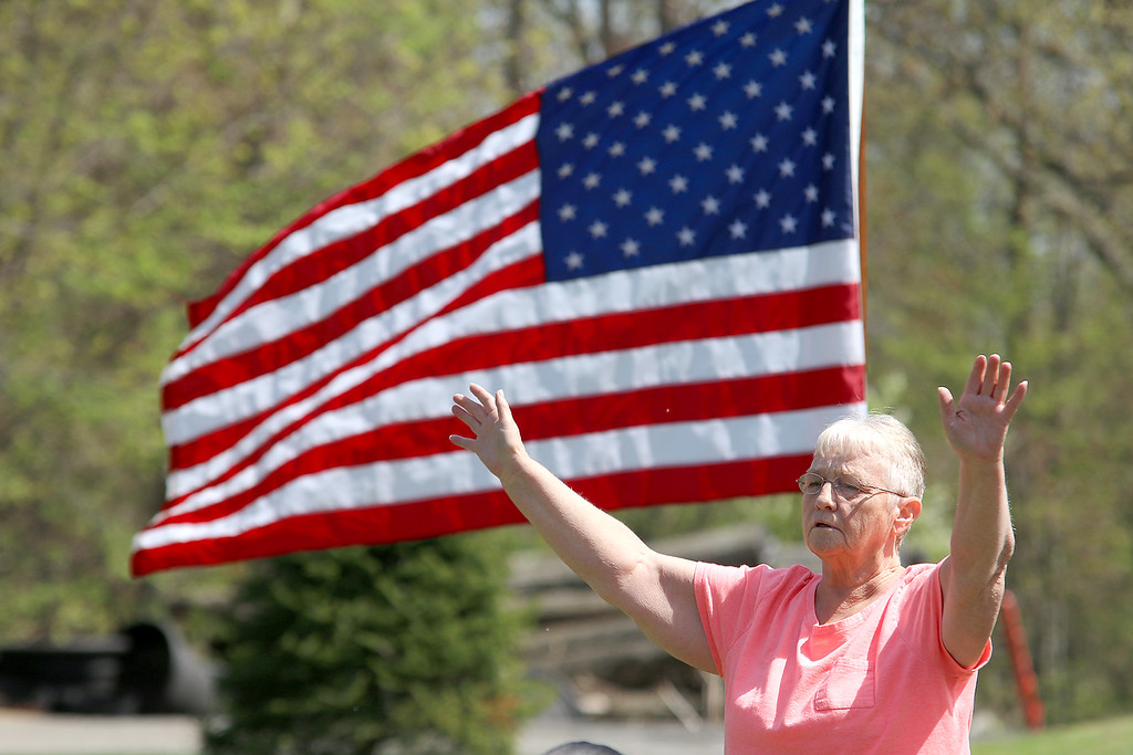 . National Day of Prayer was held at Barrett Park on Thursday, May 4, 2017. Terri Rivera of Fitchburg prays with the speakers during the event. SENTINEL & ENTERPRISE/JOHN LOVE