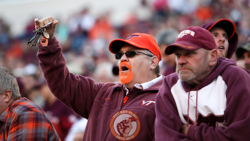 A Virginia Tech fan holds up a set of keys on a defensive third down in the first quarter. (Mark Umansky/TheKeyPlay.com)
