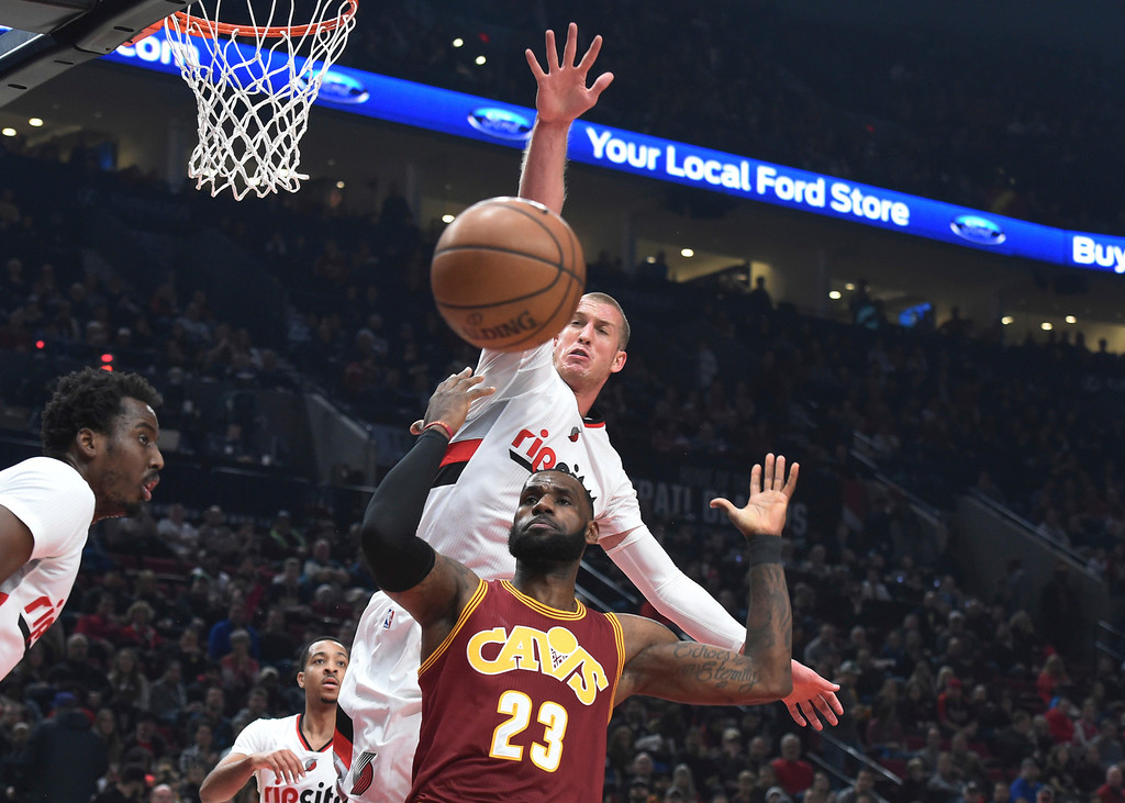 . Portland Trail Blazers center Mason Plumlee goes up to try and block the shot of Cleveland Cavaliers forward LeBron James during the first half of an NBA basketball game in Portland, Ore., Wednesday, Jan, 11, 2017. (AP Photo/Steve Dykes)
