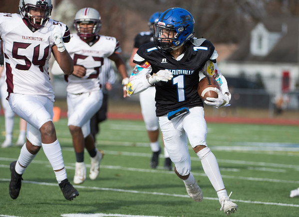11/28/19 Wesley Bunnell | StaffrrPlainville football defeated Farmington on Thanksgiving morning at Plainville High School. Javan Paradis (1)