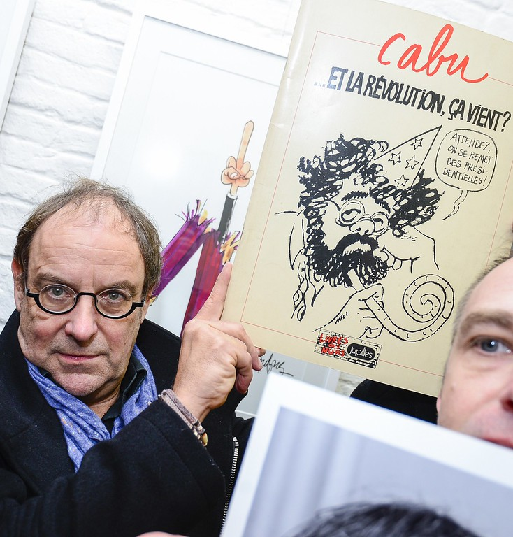 . Belgian cartoonist Kroll poses for a photograph in Brussels on January 8, 2015 during a tribute organized by the association of Belgian journalists (AJP) at the Cartoonist bookstore in Brussels in solidarity with the victims of the Charlie Hebdo shooting. French security forces were Thursday frantically hunting two brothers suspected of gunning down 12 people in an Islamist attack on a satirical weekly, as a stunned and outraged France fell silent to mourn the victims.   AFP PHOTO/ BELGA / LAURIE DIEFFEMBACQ/AFP/Getty Images