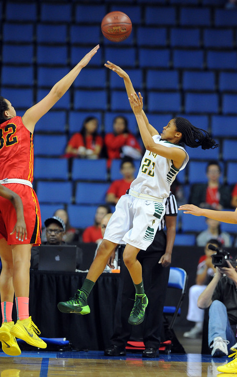 . Poly\'s Arica Carter shoots over Etiwanda\'s Daeja Smith at Citizens Business Bank Arena in Ontario, CA on Saturday, March 22, 2014. Long Beach Poly vs Etiwanda in the CIF girls open division regional final. 2nd half, Poly won 56-46. Photo by Scott Varley, Daily Breeze)