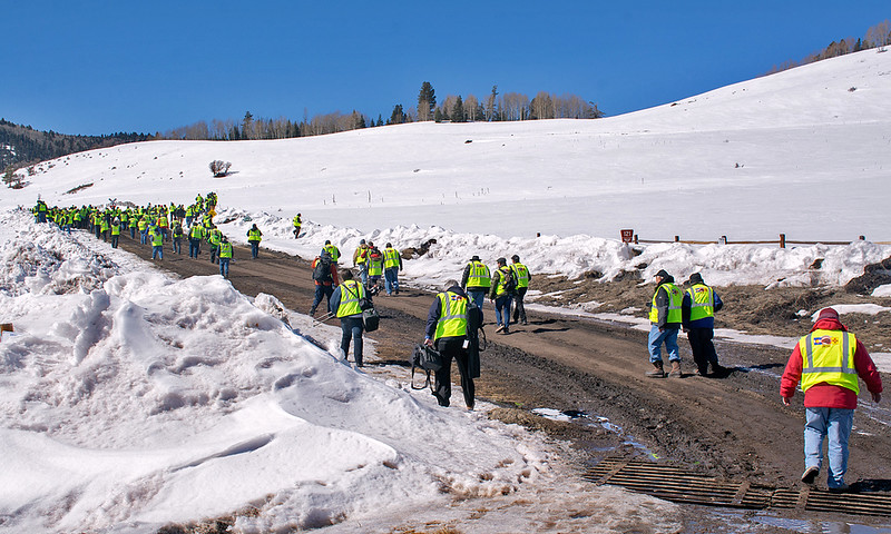 "February 29, 2020.  The ""green army"" of photographers walk up the hill to Dalton crossing."