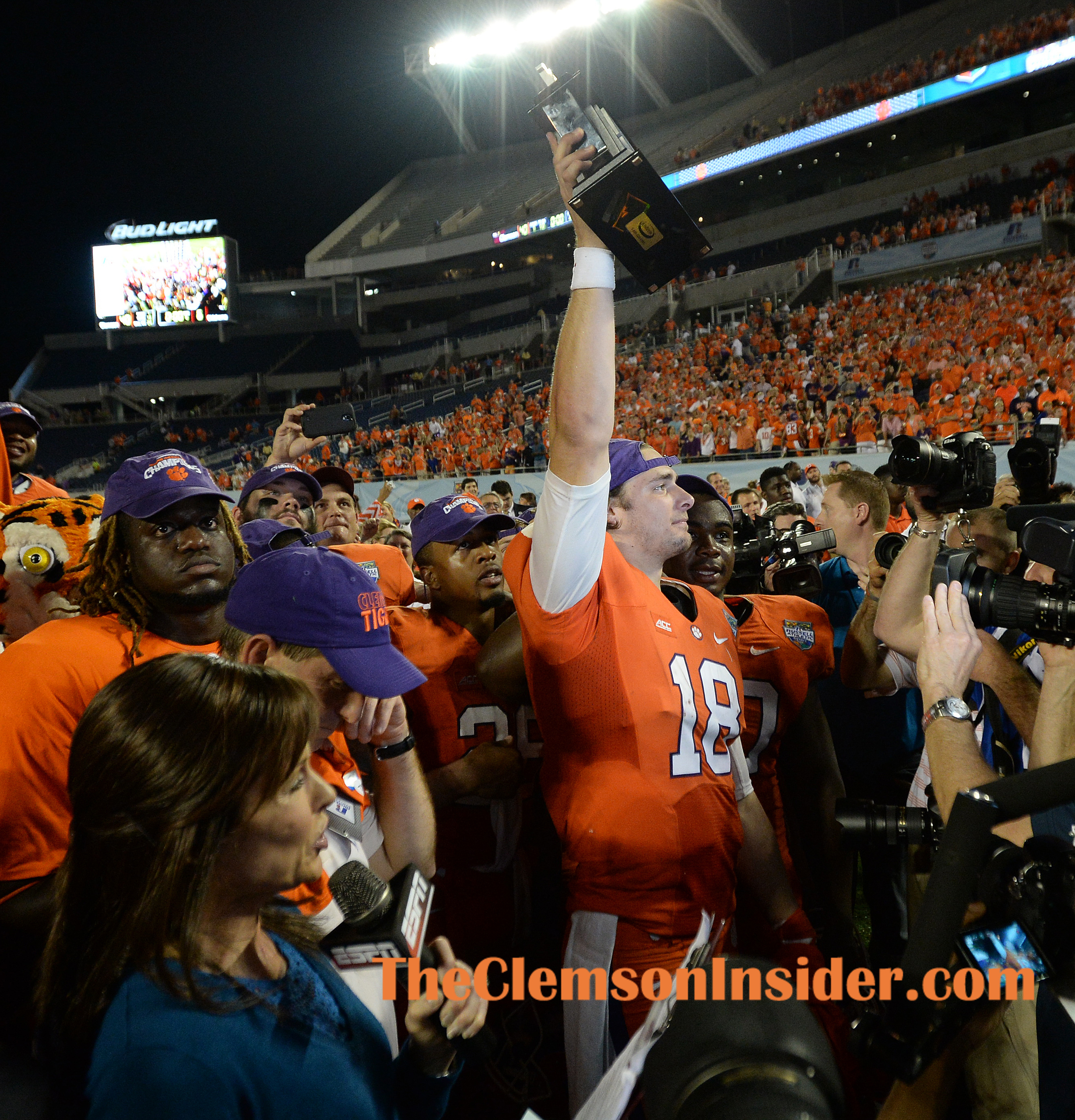 Clemson quarterback Cole Stoudt (18) holds the Russell Athletic Bowl MVP trophy after the Tigers defeated Oklahoma 40-6 Monday, December 29, 2014 in Orlando, Fl.