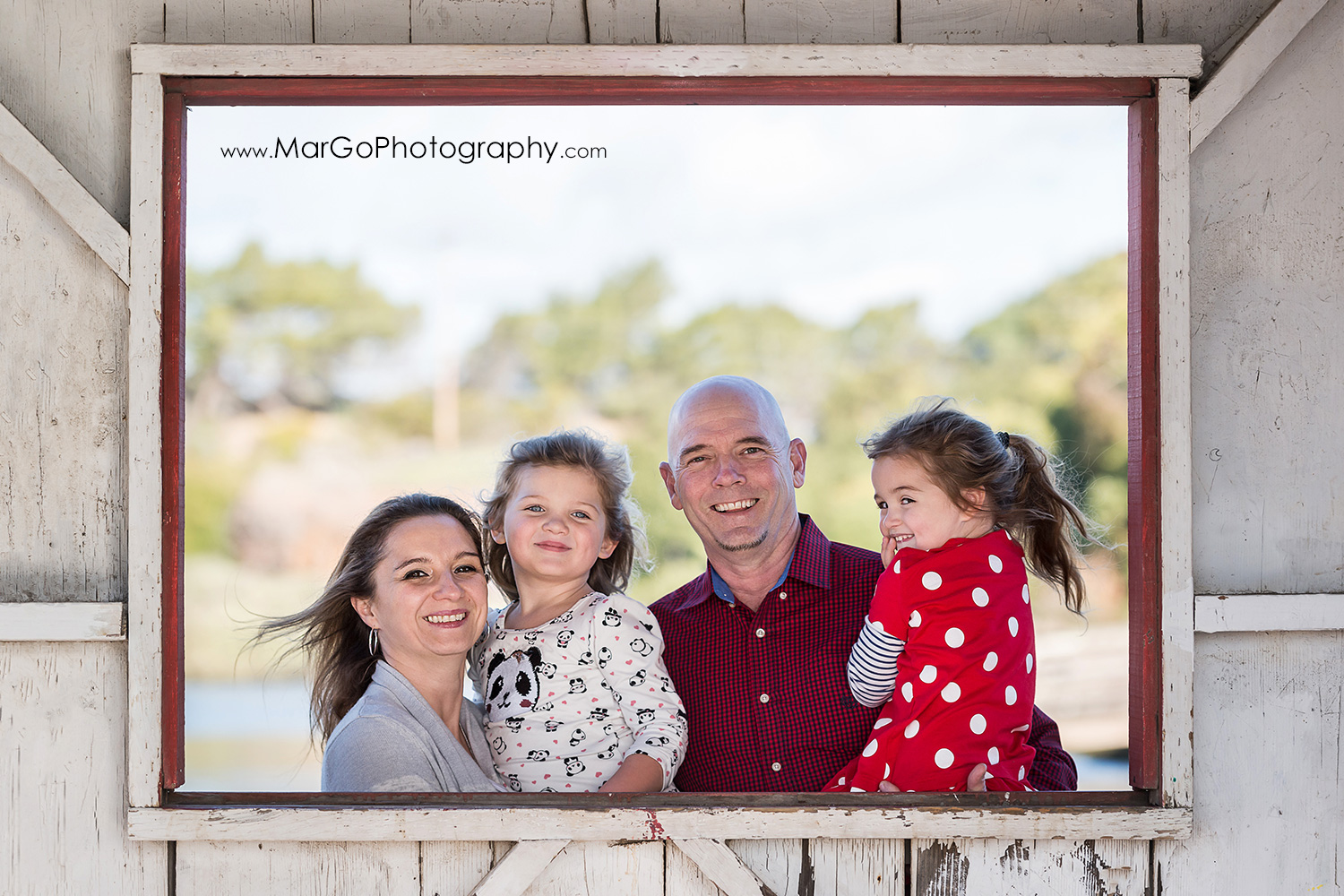 family of 4 in the frame of window of wood shed at Don Edwards Refuge in Fremont