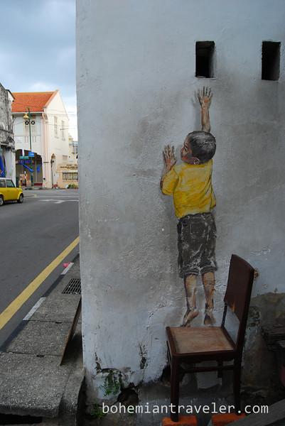 penang street art installation boy.jpg