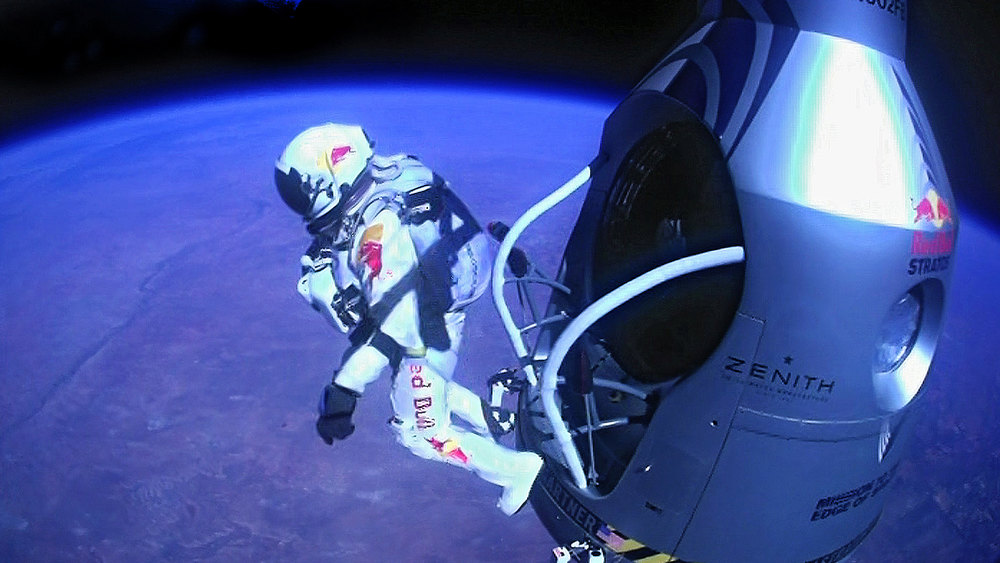 ". This Sunday, Oct. 14, 2012 file image provided by Red Bull Stratos shows pilot Felix Baumgartner of Austria as he jumps out of the capsule during the final manned flight for Red Bull Stratos. In a giant leap from more than 24 miles up, Baumgartner shattered the sound barrier Sunday while making the highest jump ever � a tumbling, death-defying plunge from a balloon to a safe landing in the New Mexico desert. ""Stratosphere jump\"" ranked as Google\'s seventh most searched trending event of 2012. (AP Photo/Red Bull Stratos)"