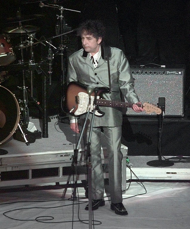 """. Bob Dylan performs the song \""""Love Sick\"""" during the 40th Annual Grammy Awards Wednesday, Feb. 25, 1998, at Radio City Music Hall in New York.  Dylan won a Grammy award for Album of the Year.  (AP Photo/Mark Lennihan)"""