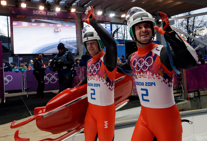 . The doubles team of Andreas Linger and Wolfgang Linger from Austria waves to supporters after their first run during the men\'s doubles luge at the 2014 Winter Olympics, Wednesday, Feb. 12, 2014, in Krasnaya Polyana, Russia. (AP Photo/Dita Alangkara)