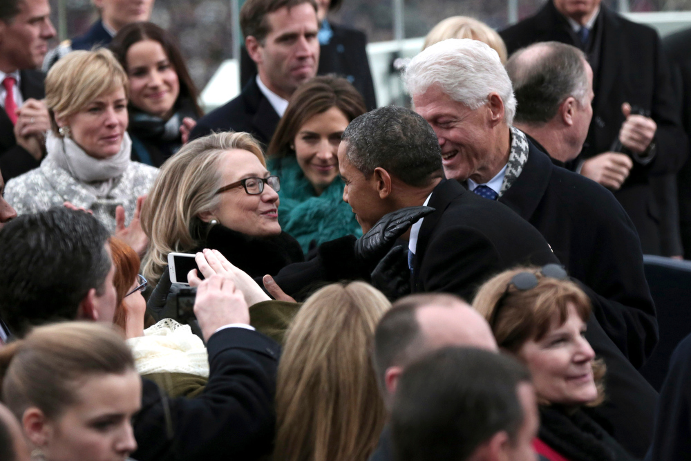Description of . President Barack Obama greets Secretary of State Hillary Rodham Clinton and former President Bill Clinton on the West Front of the Capitol in Washington, Monday, Jan. 21, 2013, before Obama's ceremonial swearing-in ceremony during the 57th Presidential Inauguration.  (AP Photo/Win McNamee, Pool)