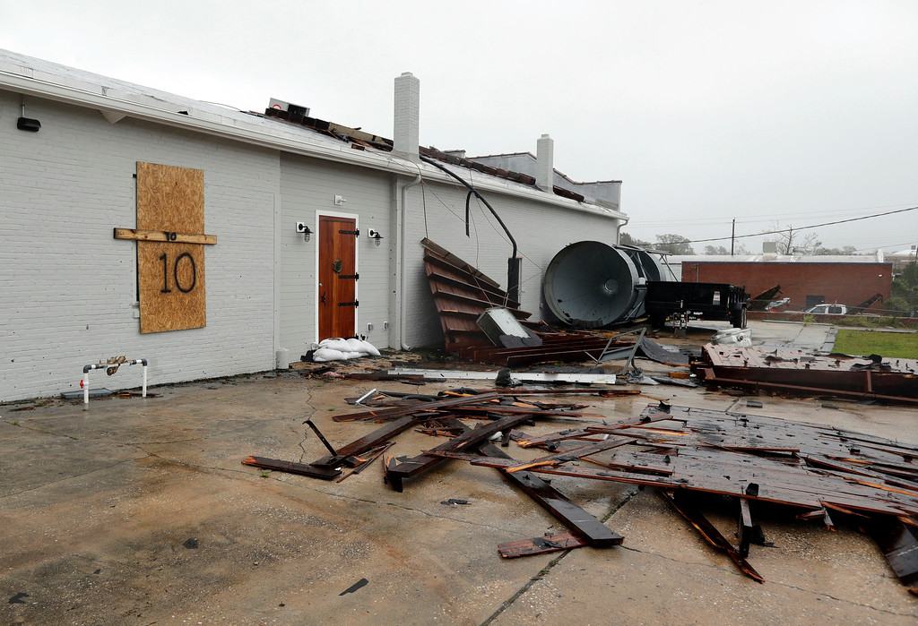 . Part of the roof of Tidewater Brewing Co. lies on the ground in Wilmington, N.C., after Hurricane Florence made landfall Friday, Sept. 14, 2018. (AP Photo/Chuck Burton)